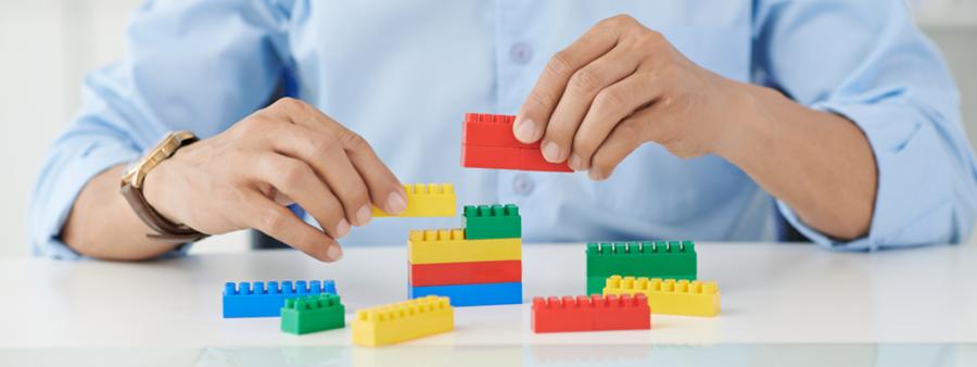 Man playing with LEGO bricks