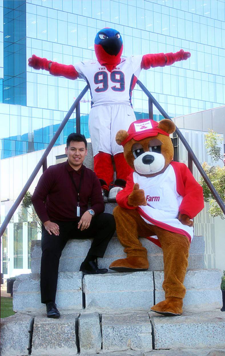 Brian Perez with Thunderbird, the Mesa Community College mascot and Bear, the State Farm mascot.