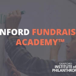 "Woman writing ""Why I Fundraise"" on board with overlaying text for Sanford Fundraising Academy"